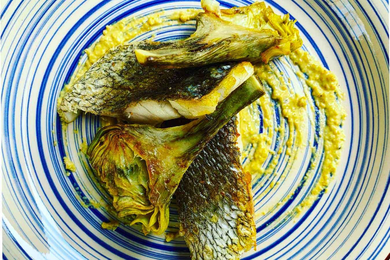 Filetto di ombrina con carciofi e salsa di vongole