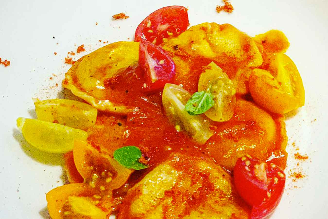 Ravioli patate, pecorino, menta e pomodoro